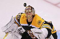 Bruins goalie Tuuka Rask keeps an eye on the puck making a save.
