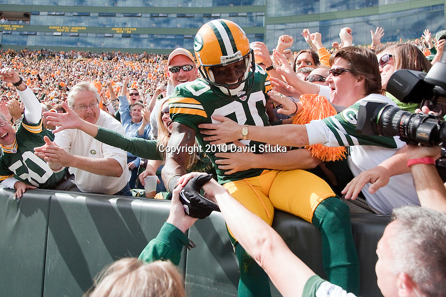 Green Bay Packers wide receiver Donald Driver (80) celebrates a touchdown with a Lambeau Leap during an NFL football game against the Buffalo Bills in Green Bay, Wisconsin on September 19, 2010. The Packers won 34-7. (AP Photo/David Stluka)
