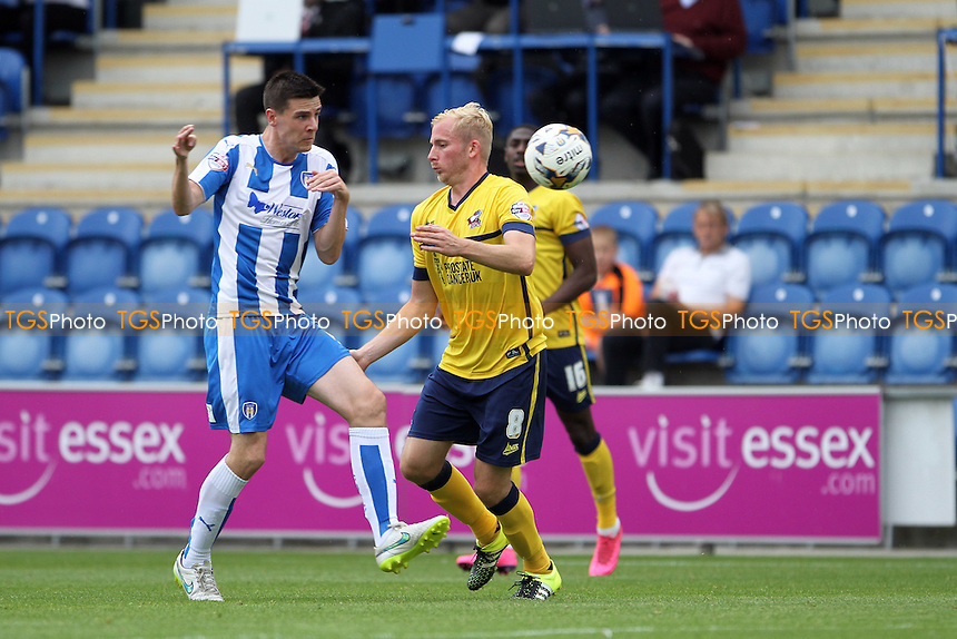 Owen Garvan of Colchester United and David Syers of Scunthorpe United both go for the ball during Colchester United vs Scunthorpe United, Sky Bet League 1 Football at the Weston Homes Community Stadium, Colchester, England on 29/08/2015
