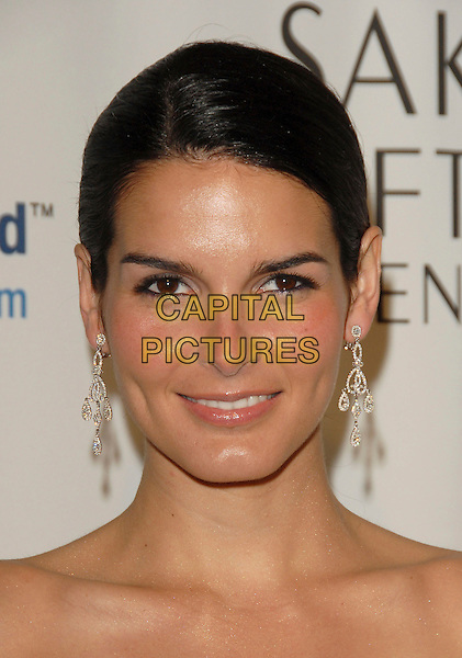 ANGIE HARMON.The Saks Fifth Avenue's Unforgettable Evening benefiting The EIF Women's Cancer Research Fund,Honoring Melissa Etheridge held at The Regent Beverly Wilshire Hotel in Beverly Hills, California, USA..March 1st, 2006.Ref: DVS.headshot portrait dangling diamond earrings.www.capitalpictures.com.sales@capitalpictures.com.Supplied By Capital PIctures