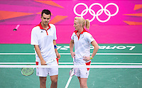 28 JUL 2012 - LONDON, GBR - Chris Adcock (GBR) (left) and Imogen Bankier (GBR) (right) of Great Britain discuss tactics during the London 2012 Olympic Games mixed doubles group match against Alexandr Nikolaenko and Valeria Sorokina of Russia at Wembley Arena, London, Great Britain (PHOTO (C) 2012 NIGEL FARROW)