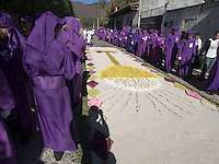 Antigua, Guatemala: During the observance of  Lent in Guatemala, the Catholic celebrations leading to Holy Week,  venerated images of Jesus and the Holy Virgin  are carried from their churches through the city on the shoulders of devoted followers who are burning incense while dressed in purple robes with white waistbands.