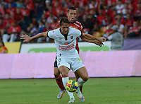 MEDELLÍN -COLOMBIA-03-08-2014. John Hernandez (Der) jugador de Independiente Medellín disputa el balón con Lenadro Diaz(Izq)  jugador del Once Caldas de la fecha 3 de la Liga Postobón II 2014 realizado en el estadio Atanasio Girardot de la ciudad de Medellín./ John Hernandez (R) player of Independiente Medellin fights the ball with Lenadro Diaz (L) player of Once Caldas during 3th date of Postobon  League II 2014 at Atanasio Girardot stadium in Medellin city. Photo: VizzorImage/Luis Ríos/STR