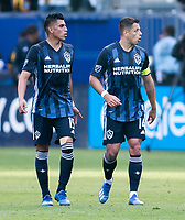 """CARSON, CA - FEBRUARY 15: Joe Corona #15 and Javier """"Chicharito"""" Hernandez #14 of the Los Angeles Galaxy during a game between Toronto FC and Los Angeles Galaxy at Dignity Health Sports Park on February 15, 2020 in Carson, California."""