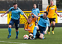 Forfar's Mark McCulloch (2) and Michael Bolochoweckyj (4) stop Alloa's Ryan McCord.