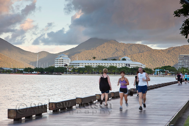 Joggers on the Esplanade boardwalk.  Cairns, Queensland, Australia