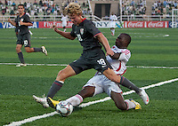 Andrew Craven tries to avoid the tackle. US Men's National Team Under 17 defeated Malawi 1-0 in the second game of the FIFA 2009 Under-17 World Cup at Sani Abacha Stadium in Kano, Nigeria on October 29, 2009.
