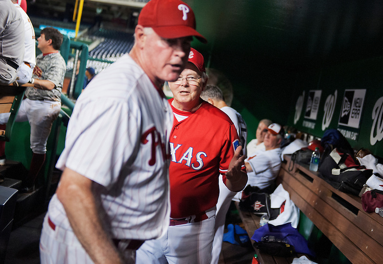 UNITED STATES - JUNE 25: Coach Joe Barton, R-Texas, tries to calm down Rep. Patrick Meehan, R-Pa., in the Republican dugout after Meehan was pulled from the mound during the 53rd Congressional Baseball Game from the Republican team dugout in Nationals Park, June 25, 2014. The Democrats prevailed over the Republicans 15-6 in a rain shortened game. (Photo By Tom Williams/CQ Roll Call)