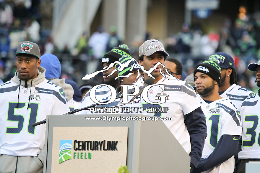2014-02-05:  Seattle Seahawks quarterback Russell Wilson thanks fans for coming out to support the Seahawks.  Seattle Seahawks players and 12th man fans celebrated bringing the Lombardi trophy home to Seattle during the Super Bowl Parade at Century Link Field in Seattle, WA.