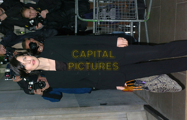 GINA MCKEE.South Bank Show Awards at the Savoy Hotel.23 January 2004.black trouser suit, bag.www.capitalpictures.com.sales@capitalpictures.com.©Capital Pictures