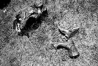 A protective vest and cowboy boots lie on the ground at the annual Lincoln Rodeo in Lincoln, MT in June 2006.  The Lincoln Rodeo is an open rodeo, which means competitors need not be a member of a professional rodeo association.
