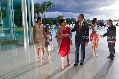 "March 19, 2011.""The late afternoon light was bouncing off the glass and steel at the Palacio do Alvorada in Brasilia, Brazil, as the President and his family arrived to greet Brazilian President Dilma Rousseff and foreign Minister Antonio Patriota. I was backpedaling as I made this picture and in retrospect wish that I had taken this at a lower angle."".Mandatory Credit: Pete Souza - White House via CNP"