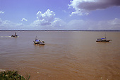 Belem, Para State, Brazil. Small riverboats on one waterway of the Amazon River with the far bank visible.