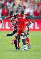 22 October 2011: New England Revolution forward Milton Caraglio #9 and Toronto FC defender Andy Iro #3 in action during a game between the New England Revolution and Toronto FC at BMO Field in Toronto..The game ended in a 2-2 draw.