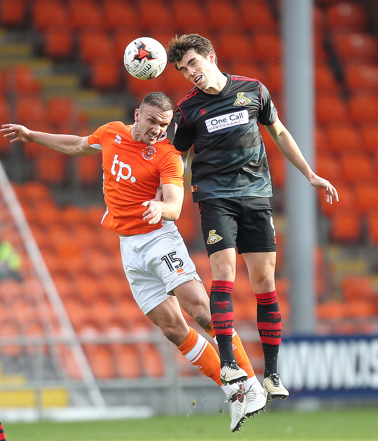 Blackpool's Tom Aldred battles with  Doncaster Rovers' John Marquis<br /> <br /> Photographer Mick Walker/CameraSport<br /> <br /> The EFL Sky Bet League Two - Blackpool v Doncaster Rovers - Saturday 22nd October 2016 - Bloomfield Road - Blackpool<br /> <br /> World Copyright &copy; 2016 CameraSport. All rights reserved. 43 Linden Ave. Countesthorpe. Leicester. England. LE8 5PG - Tel: +44 (0) 116 277 4147 - admin@camerasport.com - www.camerasport.com