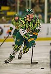 24 November 2013: University of Vermont Catamount Defenseman Yvan Pattyn, a Sophomore from St. Anne, Manitoba, in first period action against the University of Massachusetts Minutemen at Gutterson Fieldhouse in Burlington, Vermont. The Cats wore special camouflage jerseys to celebrate Military Appreciation Day. The game-worn jerseys were auctioned off with proceeds benefiting the Vermont Veterans Fund (VVF). The Catamounts shut out the Minutemen 2-0 to sweep the 2-game home-and-away weekend Hockey East Series. Mandatory Credit: Ed Wolfstein Photo *** RAW (NEF) Image File Available ***