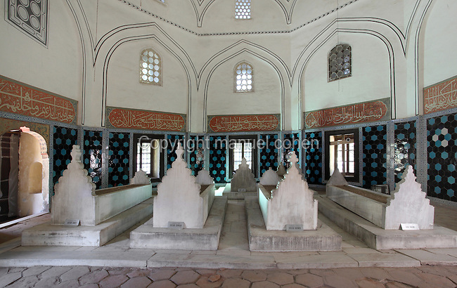 Tomb of Prince Ahmed, erected by decree of Yavuz Sultan Selim in 1513, in the Muradiye Hudavendigar mosque complex, Bursa, Turkey. This complex contains the mosque of Sultan Murat II (Muradiye mosque) and the tombs of many early Ottoman princes and sultans. This tomb was built by architect Alaeddin, with Bedrettin Bey and the scribes Ali, Yusuf, Muhiddin and Mehmed Efendi. Prince Ahmed, son of Bayezid II, his mother Bulbul Hatun, his daughter Kamer Sultan, his younger brother Prince Sehinsah, Bayezid's daughter Sofu Fatma Sultan and Sehinsah's son Mehmed are also buried here. The tomb has an octagonal plan and its walls are made of one layer of ashlar and two layers of brick, consecutively, with three rows of windows on each side. Picture by Manuel Cohen