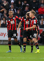 Dan Gosling of Bournemouth  (C) celebrates his goal with team mates, making the score 2-0 to his team during the Barclays Premier League match between Swansea City and Bournemouth at the Liberty Stadium, Swansea on November 21 2015