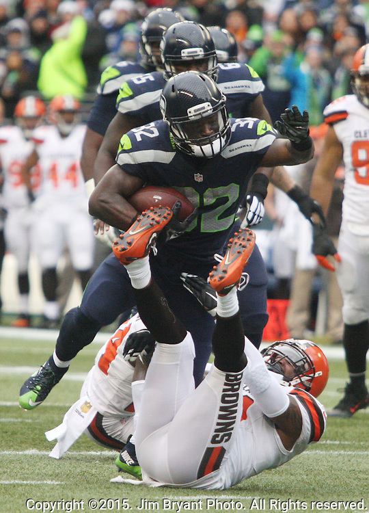 Seattle Seahawks running back Michael Michael (32) runs over Cleveland Browns defensive back Johnson Bademosi (24) at CenturyLink Field in Seattle, Washington on December 20, 2015. The Seahawks clinched their fourth straight playoff berth in four seasons by beating the Browns 30-13.  ©2015. Jim Bryant Photo. All Rights Reserved.