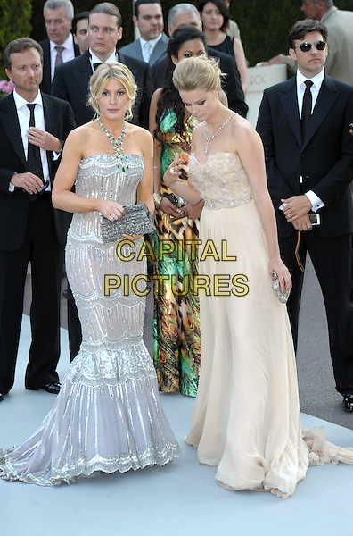 HOFIT GOLAN & HELENA HOUDOVA.The amfAR - Cinema against AIDS Gala 2010 at the Hotel du Cap-Eden-Roc in Antibes, France. .May 20th, 2010  .full length long maxi dress strapless silver jewel encrusted gem crystals clutch bag fishtail looking down beige cream strapless .CAP/RD.©Richard Dean/Capital Pictures.