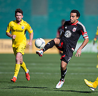 Dwayne De Rosario (7) of D.C. United takes a first touch on the ball during the game at RFK Stadium in Washington, DC.  Columbus Crew defeated D.C. United, 2-1.