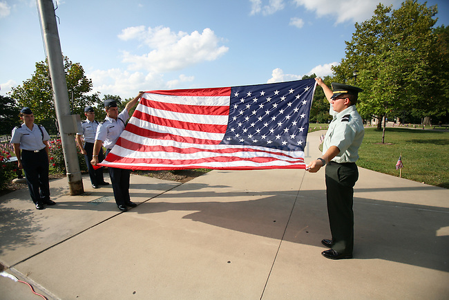 Secondary education junior Adam Crawford, right, folds the American flag in the retreat ceremony with finance senior, Curt DeJaco for a Sept. 11 memorial put on by the UK ROTC Friday afternoon. Photo by Adam Wolffbrandt | Staff.
