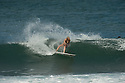 Girl Surfing at Rocky Pt on the North Shore of Oahu in Hawaii.