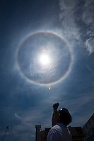 "An atmospheric phenomenon known as a ""sun dog"" is seen at Seaside Heights, in New Jersey  May 14, 2013, Photo by Eduardo Munoz Alvarez / VIEWpress."