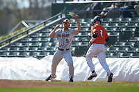West Virginia Mountaineers first baseman Ryan Archibald (5) stretches for a throw as Jacob Campbell (9) of the Illinois Fighting Illini runs towards first base at TicketReturn.com Field at Pelicans Ballpark on February 23, 2020 in Myrtle Beach, South Carolina. The Fighting Illini defeated the Mountaineers 2-1.  (Brian Westerholt/Four Seam Images)