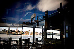 A lone sailboat, seen through a closed restaurant on the waterfront, drifts past Mare Island, in Vallejo, Ca., on Friday, April 8, 2011. The City of Vallejo filed for bankruptcy in 2008, and the city is still suffering but budget cutbacks, including services for senior citizens.