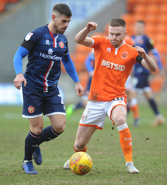 Blackpool's Oliver Turton vies for possession with Walsall's Joe Edwards<br /> <br /> Photographer Kevin Barnes/CameraSport<br /> <br /> The EFL Sky Bet League One - Blackpool v Walsall - Saturday 9th February 2019 - Bloomfield Road - Blackpool<br /> <br /> World Copyright &copy; 2019 CameraSport. All rights reserved. 43 Linden Ave. Countesthorpe. Leicester. England. LE8 5PG - Tel: +44 (0) 116 277 4147 - admin@camerasport.com - www.camerasport.com