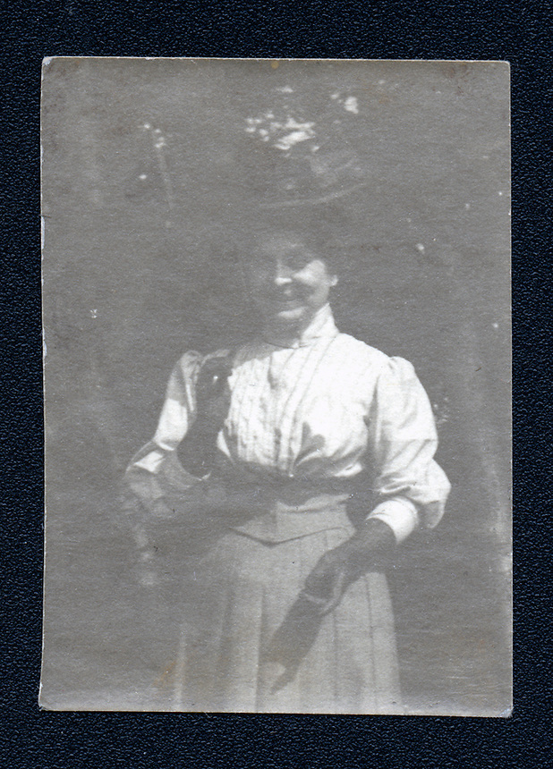 27a.<br /> <br /> 2 1/16  x  1 7/16  [b+w]<br /> <br /> Sarah Crone, frontal figure, three-quarter length, wearing white blouse, gloves, hat; in grove.