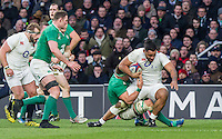 Billy Vunipola tackled by CJ Stander, England v Ireland in a 6 Nations match at Twickenham Stadium, Whitton Road, Twickenham, England, on 27th February 2016