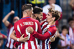 Yannick Carrasco of Atletico Madrid celebrates with teammates Fernando Torres and Antoine Griezmann during their 2016-17 UEFA Champions League match between Atletico Madrid vs FC Bayern Munich at the Vicente Calderon Stadium on 28 September 2016 in Madrid, Spain. Photo by Diego Gonzalez Souto / Power Sport Images