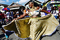 Jessica Davis, on the royal court of Marvin Marvi Millon at the Divine Ladies Second Line parade, 2018