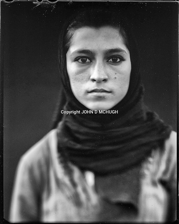 "Madina Saidi, a skateboarder and instructor at the Skateistan NGO, is seen at Bibi Moru in Kabul, 23 August 2012. This portrait was shot on a 5x4 Linhof Technika IV, circa 1959, and a Schneider Kreuznach 270mm lens, circa 1952, with front tilt, and is part of a series entitled ""Putting an Afghan face on the war."" (John D McHugh)"
