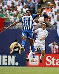 10 June 2007: Honduras' Carlos Costly (13) and Mexico's Jose Andres Guardado (18) challenge for the ball. The Honduras Men's National Team defeated the National Team of Mexico 2-1 at Giants Stadium in East Rutherford, New Jersey in a first round game in the 2007 CONCACAF Gold Cup.