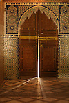 Light shines through a door in a room in the Bahia Palace in Marrakesh, Morocco.