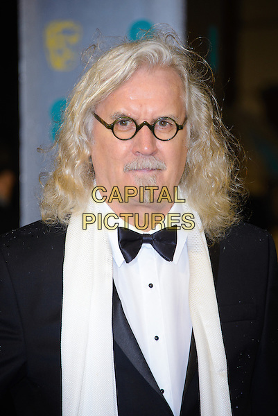 Billy Connolly.EE British Academy Film Awards at The Royal Opera House, London, England 10th February 2013.BAFTA BAFTAS arrivals headshot portrait black white tuxedo bow tie shirt scarf glasses goatee soul patch moustache mustache facial hair .CAP/CJ.©Chris Joseph/Capital Pictures