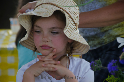Young girl thoughtful in garden camp, Yarmouth Maine, USA
