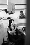 "Paul and Linda McCartney Wings Tour 1975. Paul and Linda in the band rehersal studio dressing room Elstree, London.. The photographs from this set were taken in 1975. I was on tour with them for a children's ""Fact Book"". This book was called, The Facts about a Pop Group Featuring Wings. Introduced by Paul McCartney, published by G.Whizzard. They had recently recorded albums, Wildlife, Red Rose Speedway, Band on the Run and Venus and Mars. I believe it was the English leg of Wings Over the World tour. But as I recall they were promoting,  Band on the Run and Venus and Mars in particular."