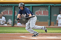 Tony Campana (4) of the Reno Aces attempts to drag a bunt against the Salt Lake Bees at Smith's Ballpark on May 4, 2014 in Salt Lake City, Utah.  (Stephen Smith/Four Seam Images)