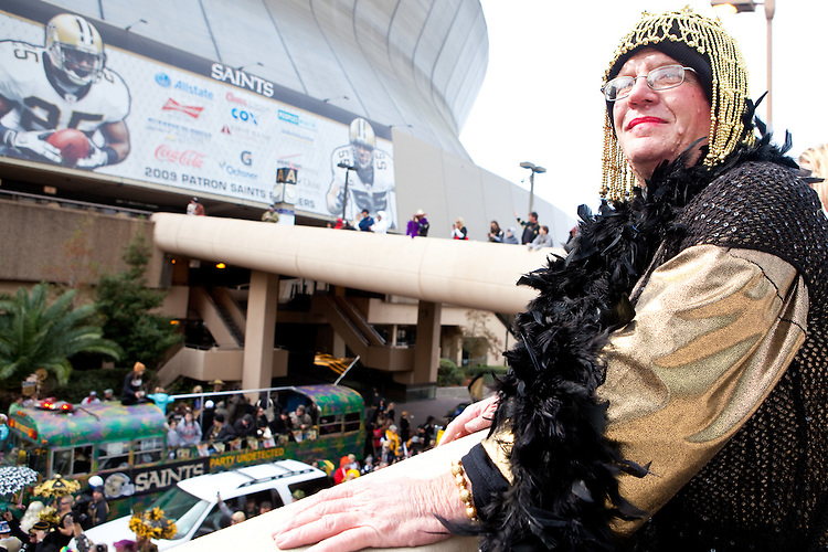 Jesse Mamury overlooks the wild scene at the start of a parade in Buddy D's honor on January 31, 2010 in New Orleans.<br /> <br /> Thousands of Saints fans wearing dresses paraded from the Louisiana Superdome to the French Quarter to honor a promise made by the late sportscaster and Saints super-fan Buddy Diliberto aka &quot;Buddy D&quot;.<br /> <br /> In 1993 Buddy D, who passed away in 2005, remarked on air that if the Saints were to make it to the Super Bowl, he would wear a dress and dance down the streets.  The comment was repeated at various times and never forgotten by his listeners.<br /> <br /> Led by former New Orleans Saints quarterback Bobby Hebert, who has taken Buddy D's place on WWL radio, thousands made good on his promise for him, dancing, drinking, and cavorting their way down the street, alternately yelling out &quot;Who Dat!&quot; and &quot;Buddy D!&quot; in front of an onlooking crowd an estimated 85,000 people strong.<br /> <br /> The hard luck NFL team the New Orleans Saints has reached its first Super Bowl in team history, after 43 years largely filled with losing seasons and futility.  It is difficult to travel anywhere in the area without some reminder of this fact, as the team and city are intertwined perhaps like no other sports franchise in this country.