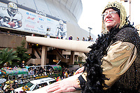 "Jesse Mamury overlooks the wild scene at the start of a parade in Buddy D's honor on January 31, 2010 in New Orleans.<br /> <br /> Thousands of Saints fans wearing dresses paraded from the Louisiana Superdome to the French Quarter to honor a promise made by the late sportscaster and Saints super-fan Buddy Diliberto aka ""Buddy D"".<br /> <br /> In 1993 Buddy D, who passed away in 2005, remarked on air that if the Saints were to make it to the Super Bowl, he would wear a dress and dance down the streets.  The comment was repeated at various times and never forgotten by his listeners.<br /> <br /> Led by former New Orleans Saints quarterback Bobby Hebert, who has taken Buddy D's place on WWL radio, thousands made good on his promise for him, dancing, drinking, and cavorting their way down the street, alternately yelling out ""Who Dat!"" and ""Buddy D!"" in front of an onlooking crowd an estimated 85,000 people strong.<br /> <br /> The hard luck NFL team the New Orleans Saints has reached its first Super Bowl in team history, after 43 years largely filled with losing seasons and futility.  It is difficult to travel anywhere in the area without some reminder of this fact, as the team and city are intertwined perhaps like no other sports franchise in this country."