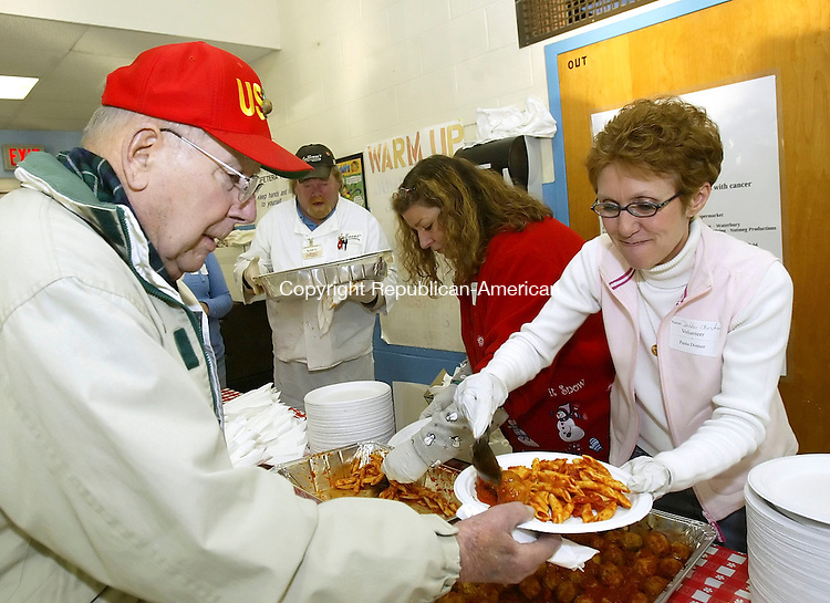 WOODBURY, CT, 03/09/07- 030907BZ05- Debbie Chester, a 5th grade teacher at Woodbury Middle School, serves meatballs to Duncan Graham, of Woodbury, during a spaghetti dinner fundraiser for Jon Sales and Erik Fisher.  The boys have been diagnosed with cancer.    <br /> Jamison C. Bazinet Republican-American