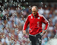 Francesco Guidolin manager of Swansea looks at the bubbles   during the Barclays Premier League match between West Ham United and Swansea City  played at Boleyn Ground , London on 7th May 2016