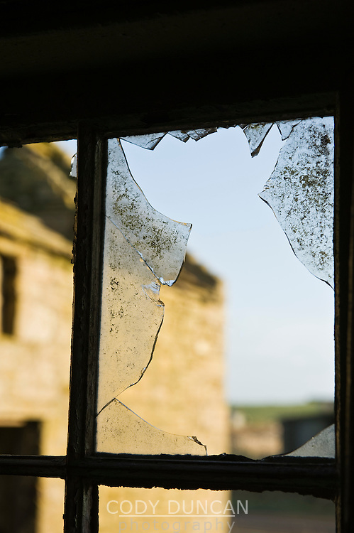 View out broken window of abanonded house, South Ronaldsay, Orkney, Scotland