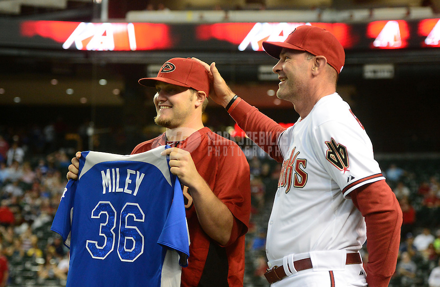 Jul. 6, 2012; Phoenix, AZ, USA: Arizona Diamondbacks pitcher Wade Miley (left) is congratulated by manager Kirk Gibson during a ceremony honoring him as an all star prior to the game against the Los Angeles Dodgers at Chase Field. Mandatory Credit: Mark J. Rebilas-