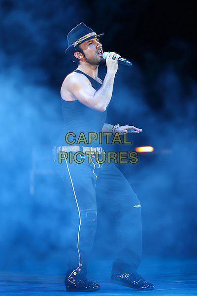 Tarkan.Concert in Moscow, Russia..November 21st 2009.on stage in concert live gig performance performing music full length black top sleeveless hat singing side profile beard facial hair .CAP/PER/SB.© SB/Persona/CapitalPictures