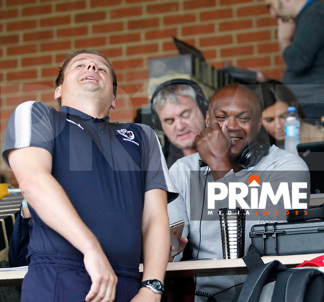 AFC Wimbledon manager, Neal Ardley and former team mate Marcus Gayle joke around during the Carabao Cup match between AFC Wimbledon and Brentford at the Cherry Red Records Stadium, Kingston, England on 8 August 2017. Photo by Carlton Myrie.